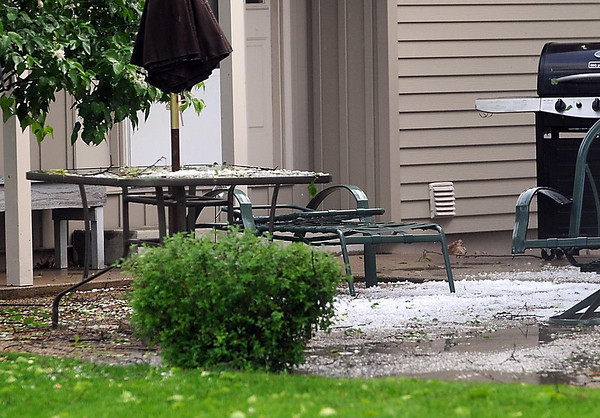 Hail stones pile up on a homeowner's patio on Bittersweet Lane Wednesday.