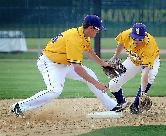John Cross<br /> Mavericks shortstop Todd Standish (left) and second baseman Matt Kuckenbecker mishandle a potential double play ball in the fifth inning of the opening game against Southwest Minnesota State Monday.