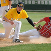 John Cross<br /> Mankato West's Nicholas Allen gets under the tag of East's Jordan Grams to safely steal second in the second inning.