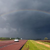 A car passes under a rainbow along County Road 90 south of Mankato after a severe thunderstorm moved through Wednesday evening.