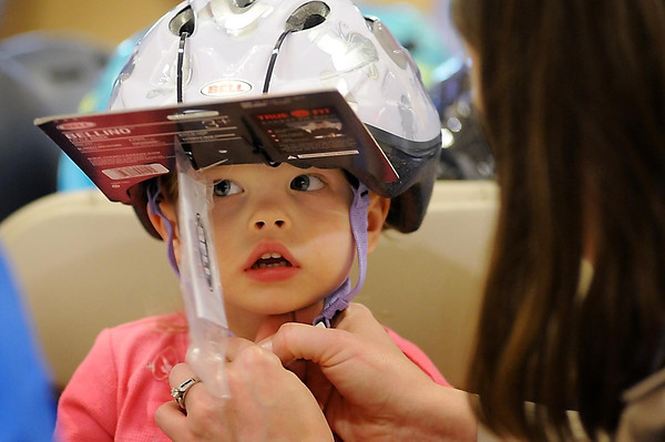 John Cross<br /> Cora Johannes, 2-year-old daughter of Chris and Jamie Johannes is fitted with a helmet at a Bicyle Safety Rally at the River Hills Mall on Thursday.