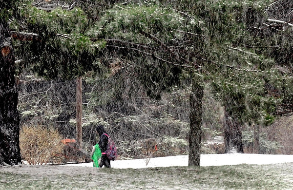 Pat Christman<br /> A Minnesota State University student is surrounded by a swirl of snow on campus Wednesday.