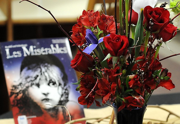 "John Cross<br /> Red roses were a key part of a floral arrangement paired to ""Les Miserables"" by Victor Hugo at Books In Bloom in the Folke Bernadotte Memorial Library at Gustavus Adolphus College."