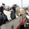 Pat Christman<br /> Katie and Jason Nichols unload their trailer in front of a pile of items left during Mankato's annual Spring Cleanup Saturday.