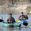 John Cross<br /> Kayaks bristling with pre-rigged catfish rods, Nick Raway (left) and Elliot Pint paddle down the Minnesota River near Sibley Park on Monday. The anglers, guides for Wounded Warriors Guide Service,were taking advantage of the nice weather to find a few fishing spots they could take wounded service veterans later this spring.