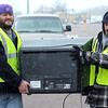 Pat Chrsitman<br /> Baxter Hoffman, left, and Chad Schultz carry a television to a truck to be recycled.
