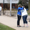Two women embrace after leaving a community meeting on school safety Friday at the Waseca Junior and Senior High School. Police thwarted a 17-year-old Waseca boy's attempt to place bombs in the school earlier this week. Photo by Pat Christman