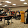 Media and comminity members listen as Waseca Police Capt. Kris , flanked by Waseca School Superintendent Thomas Lee, answers questions Thursday, May 1, 2014, about the arrest of a 17-year-old high school student who they say was plotting an attack on the Waseca Senior and Junior High Schools.