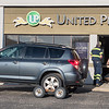 Emergency responders look into the office space of United Prairie Insurance after a driver crashed into the building along Riverfront Drive on Thursday afternoon. Photo by Jackson Forderer