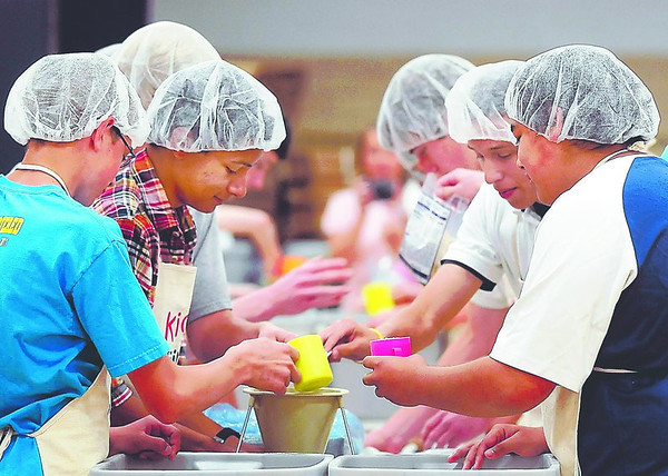 John Cross<br /> Students from St. Peter High School put together meals Friday for Kids Against Hunger. The National Honor Society,  along with the FFA and the Student Council, raised more than $8,500 to finance the service project and expected student volunteers to bag more than 30,000 meals.