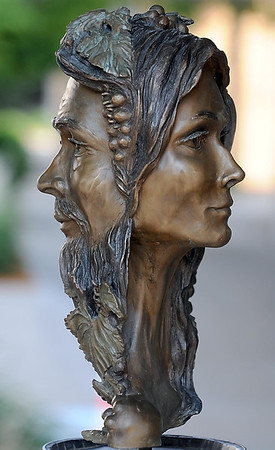 """""""The Man and the Muse,"""" with its spinning faces, is one of the new sculptures on the CityArt Walking Sculpture Tour."""