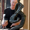 """Kasota sculptor David Hyduke talks about his sculpture, """"Tiny Dancer,"""" as it is being installed in North Mankato on the CityArt Walking Sculpture Tour Saturday morning."""