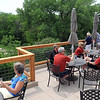 A deck behind the newly opened Chankaska Creek Ranch and Winery overlooks the grounds as visitors sample wine during a grand opening Saturday.