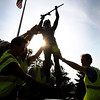 """Volunteers raise a sculpture titled """"Giving Thanks,"""" of a Native American warrior praying with his pipe, near the Verizon Wireless Center Saturday while installing new sculptures on the CityArt Walking Sculpture Tour."""