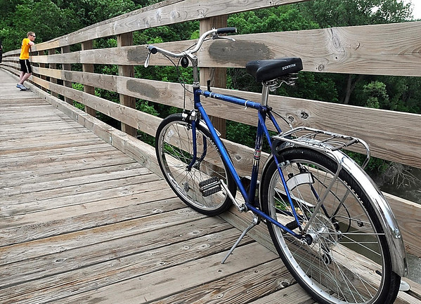 A bicycle rests on the Red Jacket trestle bridge Saturday.