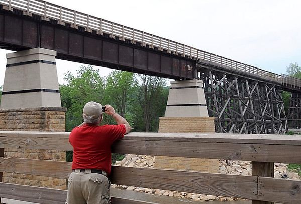 The Red Jacket trestle and her new pier were the subject of many photographs Saturday as bicycle enthusiasts and walkers celebrated the bridge's reopening.