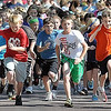 "John Cross<br /> The student body of Hoover Elementary School is off and running Friday in the annual Risser Run. Students, parents and staff jogged, ran or walked a .6-mile route in the event begun 25 years ago by physical education teacher Roger Risser as the ending activity of a three-week Jog ""N Log unit through the Mankato School District's Health Promotion Council."