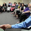 "John Cross<br /> Walter Roberts, a professor at Minnesota State University, passes a ""talking stone"" to a participant to begin a session of the Governor's Bullying Task Force that was held Monday at South Central College."