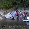 Divers work to recover the body of Jenny Mae Kraling, 21, of Mankato from the Blue Earth River Tuesday evening. Kraling was tubing with friends near the Rapidan Dam Park campground when she disappeared under the water.