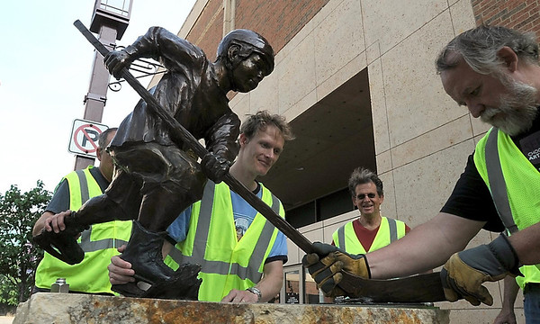 """""""Going for the Goal"""" finds an appropriate home in front of the Verizon Wireless Center, home of the Minnesota State University men's hockey team, Saturday."""