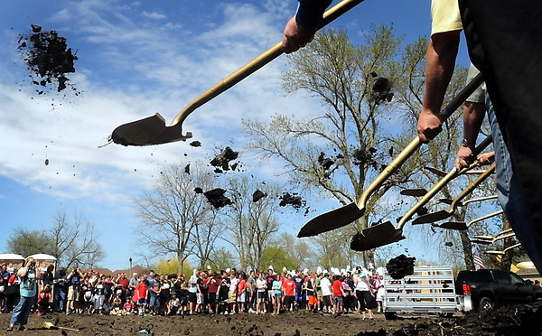 John Cross<br /> The entire student body at United South Central Schools along with community members watch on Wednesday as ceremonial shovels of dirt are tossed to kick off construction of a new school on the southwest edge of Wells. Construction on the facility is expected to be completed in the fall of 2014.