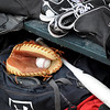 Pat Christman<br /> Baseball equipment sits in the dugout at Mankato East's Wolverton Field during a game between crosstown rivals Mankato East and Mankato West Thursday.