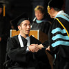 John Cross<br /> Josh Friedrichs receives his diploma and a handshake at South Central College's graduation ceremony Friday at the Verizon Wireless Center.