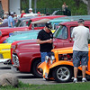 Pat Christman<br /> A group of guys check out a row of cars during Saturday's Minnesota Street Rod Association spring campout at Land of Memories Park.
