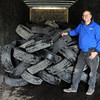 R&R Tire owner Darold Schaefer stands in a trailer partially full of tires to be recycled at his North Mankato business. Photo by Pat Christman