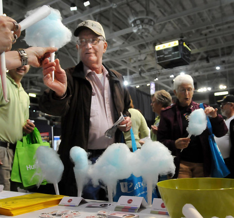 Darell and Pat Gerber of Kasota sample some cotton candy at a booth at the Senior Expo that was held at the Verizon Wireless Center on Tuesday. Photo by John Cross