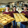 Spencer Vanderhoof (left), Natasha Frost and Tony Friesen display some of the baked goods they offer at the bakery they opened at 551 N. Front Street. Photo by John Cross