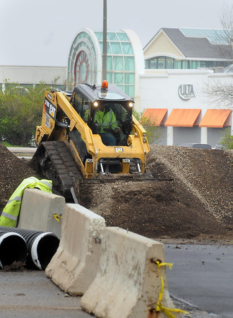 A skid loader prepares a site on Highway 22 across from the River Hills Mall that will allow motorists coming from the north access to businesses along the highway beginning June 2, when construction of roundabouts at the Madison Avenue and Adams Street are scheduled to begin. Photo by John Cross