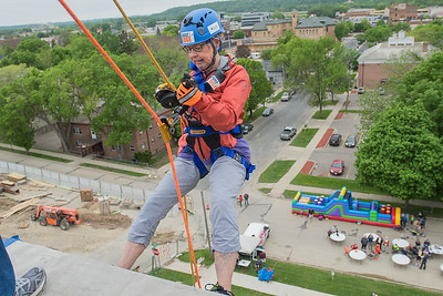 Shirley Ruby begins her descent down the VINE building on Saturday during the Over the Edge event. Those who raised $1,000 or more for VINE were given the opportunity to rappel down the five-story building. Photo by Jackson Forderer