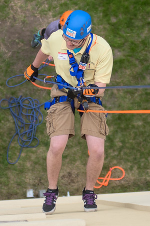 Willie Lindquist rappels down the VINE building on Saturday. The first 100 people who raised $1,000 or more for VINE were given the opportunity to rappel down the building. Photo by Jackson Forderer