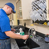 Pat Hovda grabs a water sample to test for nitrate levels at the Mankato Water Treatment Plant on Tuesday. Photo by Jackson Forderer