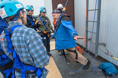 Phil Goldman puts all of his weight onto a rope to show its strength during a brief training session before people rappelled down the VINE building on Saturday. The ropes were rated at 10,000 pounds, allaying any fears the rappellers had about the ropes strength. Photo by Jackson Forderer
