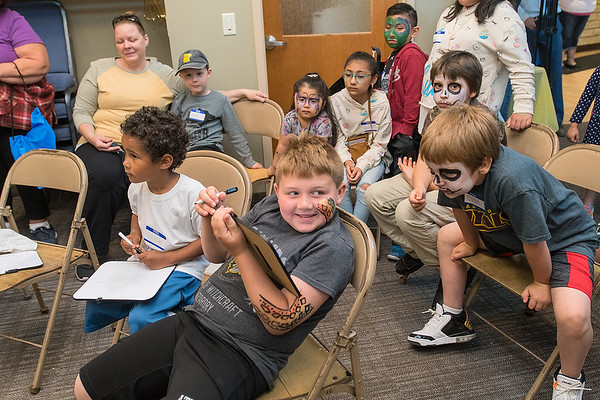 Children participate in a trivia game revolving around health issues at the Open Door Health Center's fair celebrating their 25th anniversary on Saturday. Photo by Jackson Forderer
