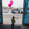 Gonzalo Balanos holds his balloons while preparing to leave the Open Door Health Center fair on Saturday. The fair included many activities for children as well as free dental screenings for children under 4 years old and medical screenings. Photo by Jackson Forderer