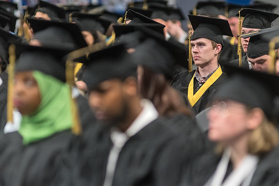 Donald Peterson listens to a speech given by South Central College professor Dr. Marie Cini at the school's commencement ceremony on Thursday. Photo by Jackson Forderer