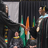 Dr. Annette Parker (right) shakes hands with a graduate during South Central College's commencement held at Bresnan Arena on Thursday. More than 600 graduates received degrees from the North Mankato and Faribault campuses. Photo by Jackson Forderer