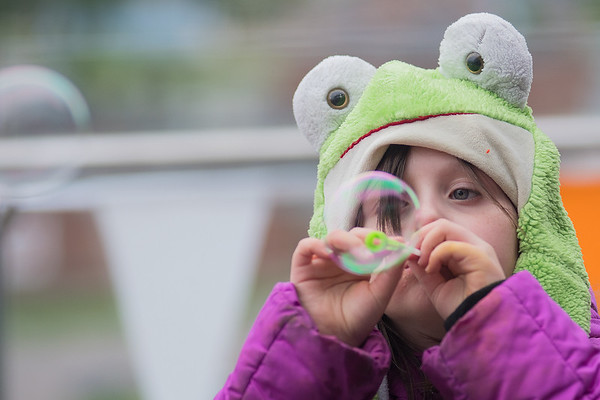 Lily Ware, 7, blows bubbles at the 410 Project Art Party held on the 7th floor of the Profinium building on Friday. Photo by Jackson Forderer