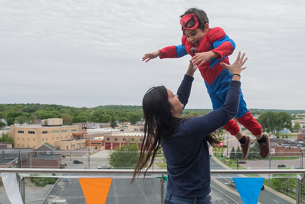 Nico Felten, 5, is tossed into the air by his mother Debbie Bernhard at the 410 Project Art Party held on Friday. The party was held on the 7th floor of the Profinium building, giving attendees panoramic views of Mankato. 410 Project Executive Director Dana Sikkila said that the event celebrated our creative community. Photo by Jackson Forderer