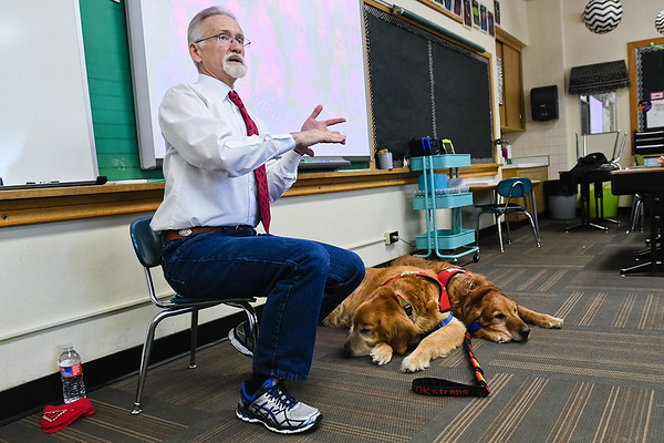 Walter Roberts, a professor at Minnesota State, tells a Roosevelt Elementary class about his two therapy dogs Prairie and Murphy during career day at the school. Photo by Jackson Forderer
