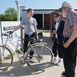 Key City Bike volunteer Caleb Mead (left) accepts a donated bike from Dave and Linda Johnson on Tuesday. The nonprofit organization has had bikes stolen from its property several times in th ...