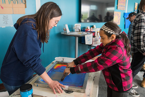 Hanna Newman (left) helps Maya Avila, 10, make a screen print at the 410 Project Art Party held on the 7th floor of the Profinium building on Friday. In addition to print making, the event included music, food and drink, a photo contest and speakers including Mike Laven from the Mankato City Council. Photo by Jackson Forderer