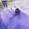 McKenzie Lee, 10, stops for a 'swim' in the purple powder during the 2nd annual Monroe Color Run. Monroe Elementary Principal Steve Johanson said that the run benefits the school's snack cart program. Photo by Jackson Forderer