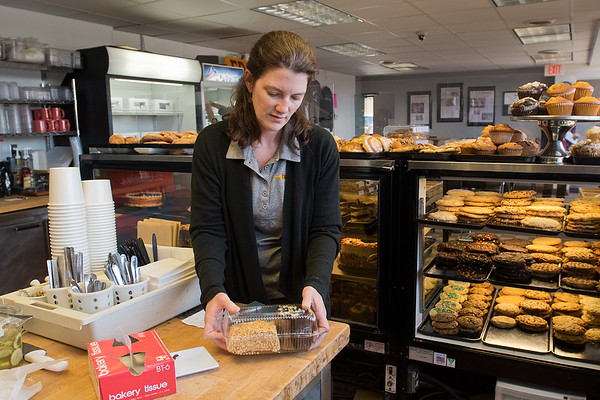 Natasha Frost, owner of Friesen's Bakery, gets bakery items ready for a customer on Friday. Friesen's has purchased the building next door and will be breaking ground on Frost Plaza which will include storefronts and apartments along Riverfront Drive. Photo by Jackson Forderer