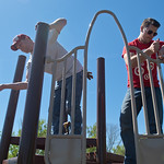 Tripp Hudson (left) and Cody Vanasse work on assembling a section of a playground on Saturday at the new Southview Park. Volunteers from the neighborhood, Target and Minnesota State pitched  ...