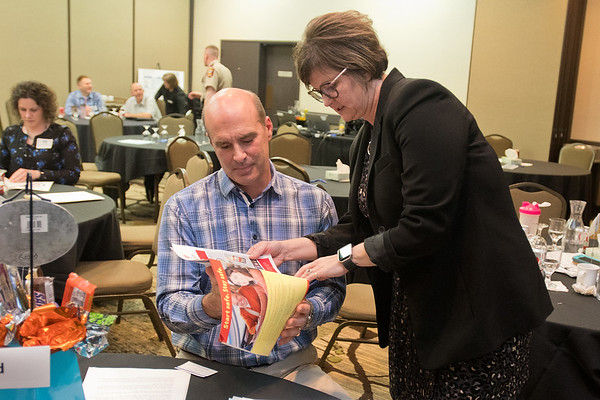 Greg Tikalsky and Lisa Kons of the Minnesota Safety Council go over a driver instructional booklet at the Towards Zero Deaths workshop held in New Ulm on Thursday. Tikalsky's father Joe was struck and killed by a driver who was texting while driving. Photo by Jackson Forderer