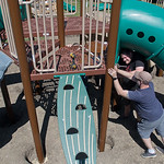 Matt Potocnik (right) pushes a pole into place while Jeff Hoag (top) puts a bolt into a section of a new playground on Saturday. The new park at the corner of Stoltzman Road and Catalina Dri ...
